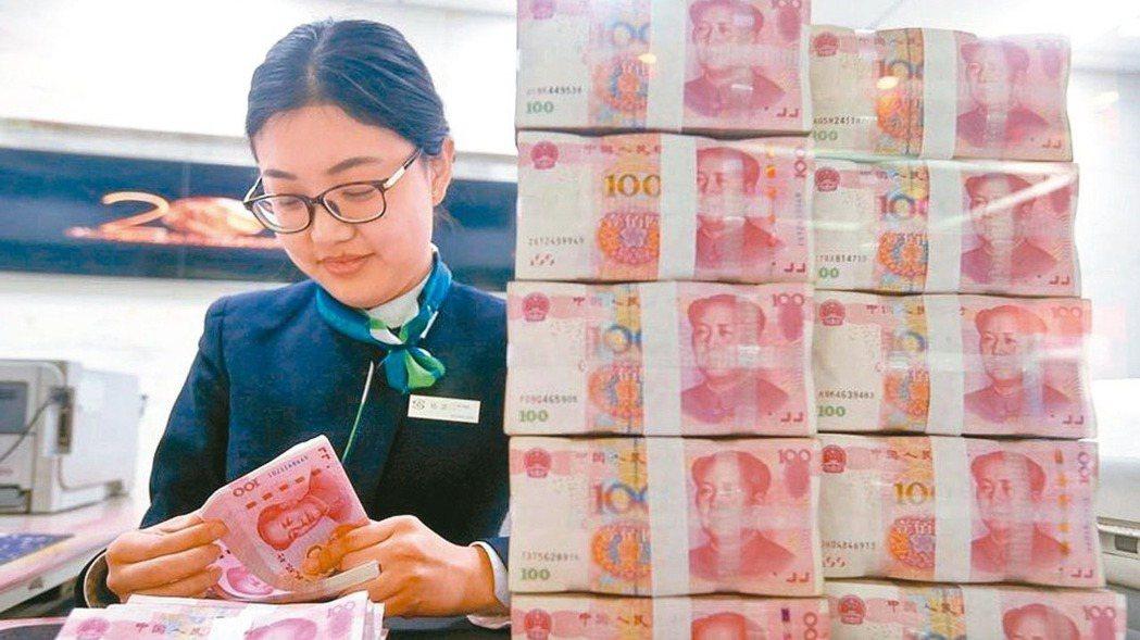 在岸離岸人民幣匯率,20日一度分別升破6.84和6.85。圖/中新社