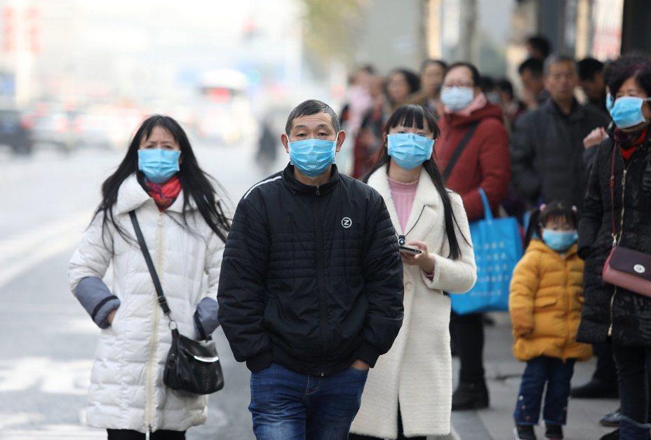 大陸武漢肺炎疫情持續延燒。圖/取自歐新社
