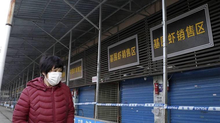 武漢海鮮市場被認為是這次疫情爆發的源頭 ,而今已經關閉。(AFP)