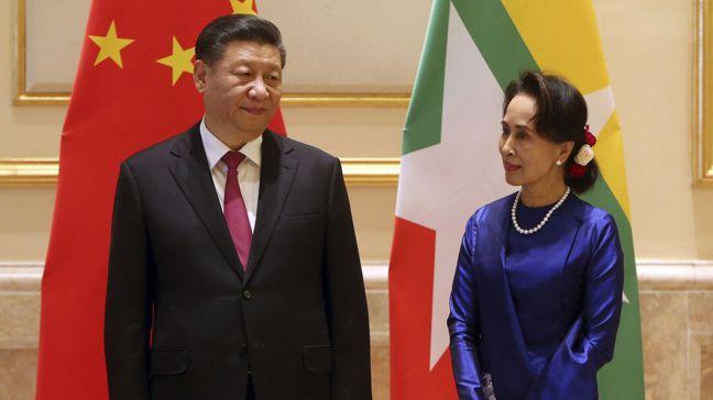 中國大陸領導人習近平(左)今年1月訪問緬甸時,特別提到要推動中緬經濟走廊。圖/美...