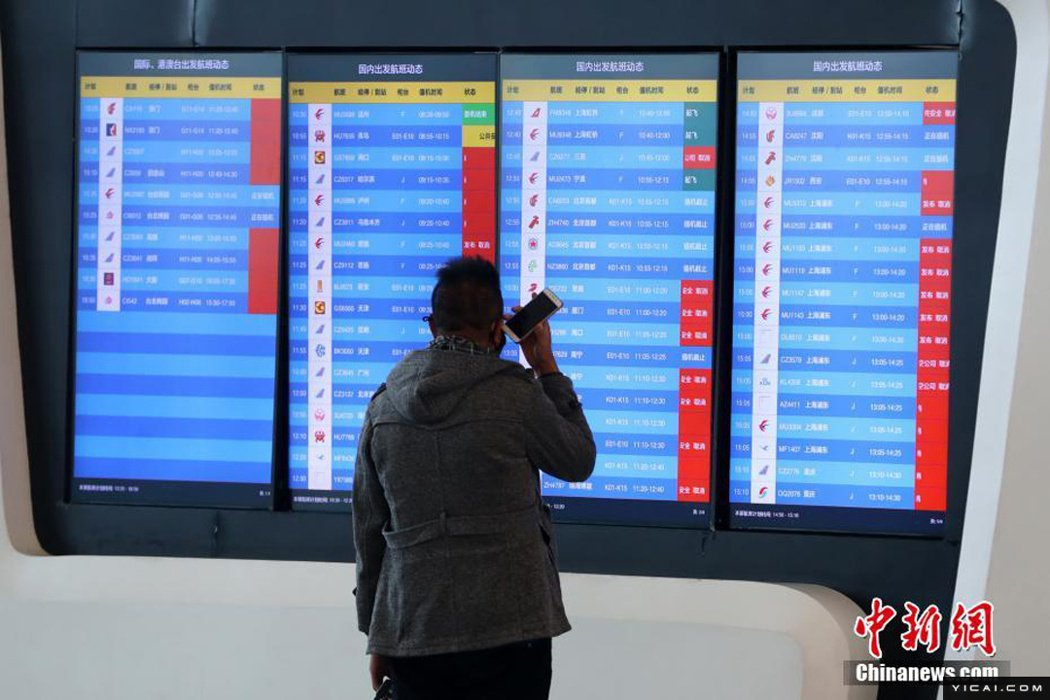 武漢天河機場23日起航班就已陸續取消。(中新網)
