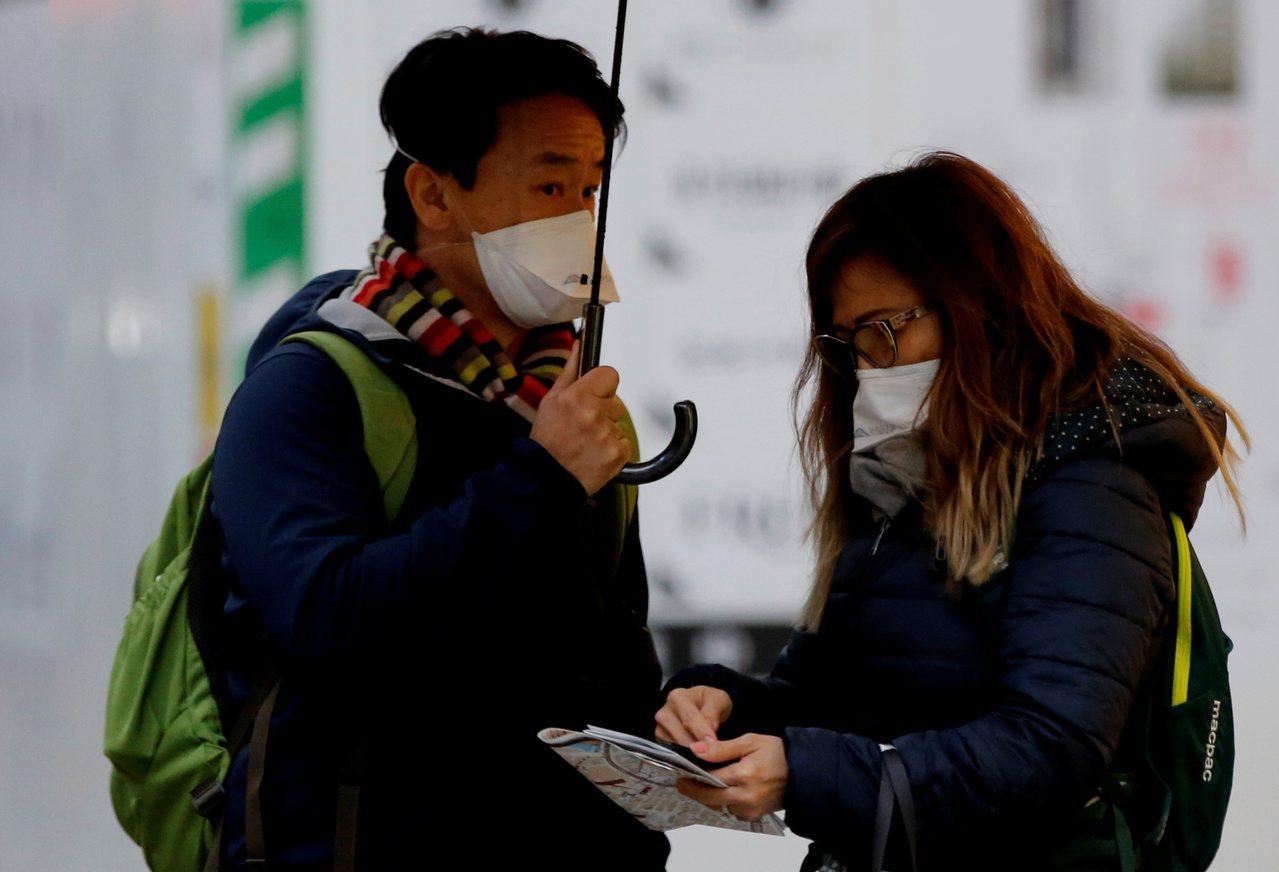 日本出現首例境內感染。圖/路透社