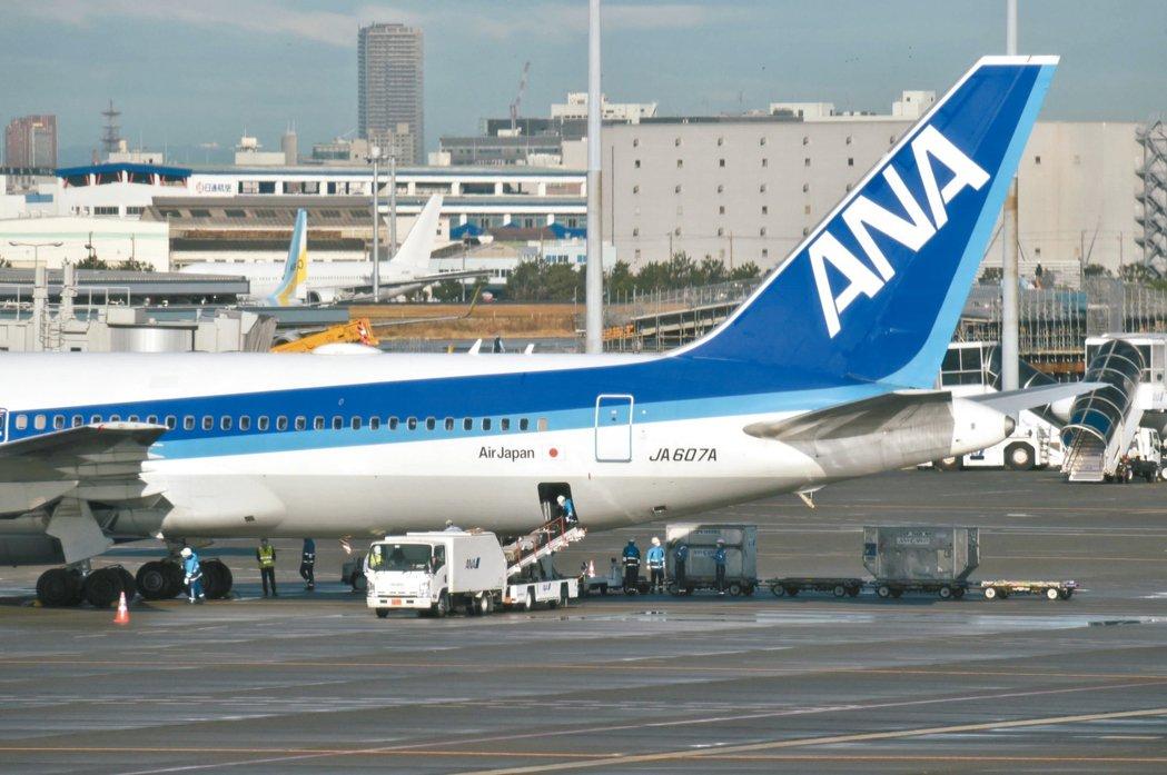 日本包機從武漢撤僑,已於29日上午飛回東京。 法新社