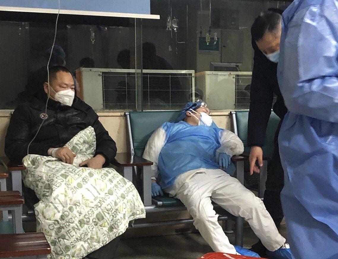 武漢肺炎的狀態,並沒有被控制的跡象。 圖/美聯社
