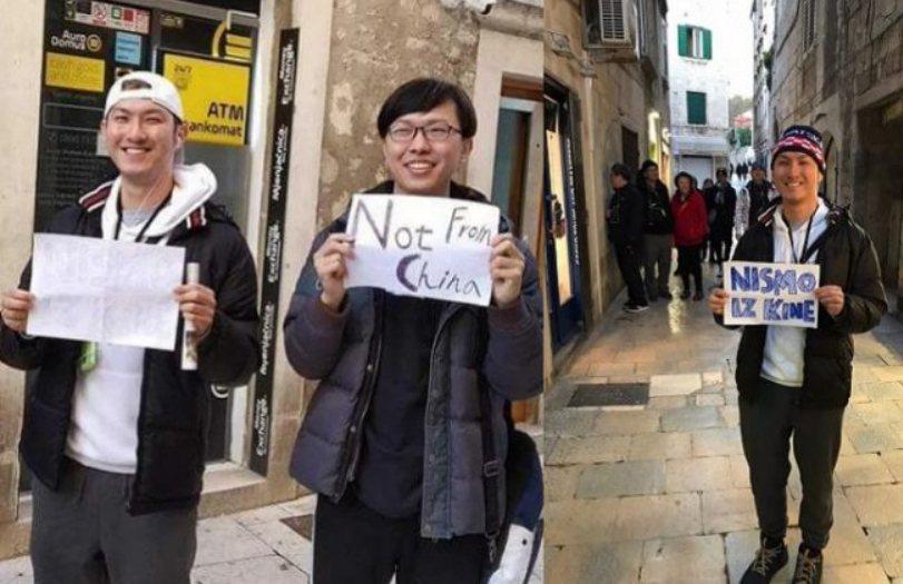 有台灣旅客到東歐遊玩,因正逢武漢肺炎肆虐期間,再加上他們的亞洲臉孔被誤以為是中國人,無奈之下只好拿著有英語和克羅埃西亞語的牌子,上面寫著「我不是中國人」的字樣,也因此登上當地媒體新聞。 圖/翻攝自ptt