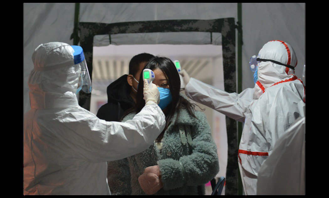 大陸武漢肺炎病例仍在激增中。圖/取自歐新社