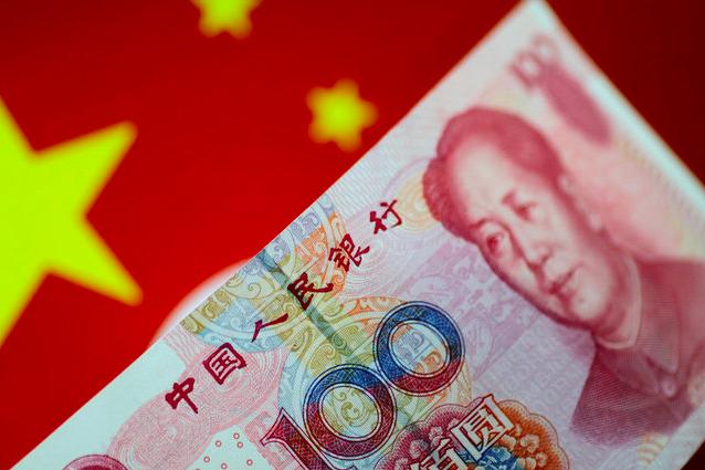 人民幣兌美元在岸價(CNY)收貶957點子或1.38%,為2015年8月11日滙改以來最大跌幅。(路透社資料照片)