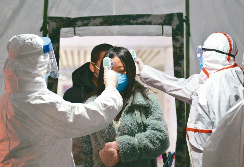 隨著疫情升溫,外媒報導,大陸全國兩會考慮延期。(歐新社)