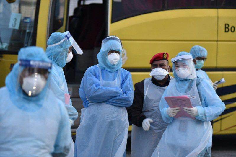 馬來西亞衛生總監諾希山表示,今(9日)新增1起2019新型冠狀病毒確診病例,患者是透過人傳人的方式受到感染,這是馬來西亞第17起確診病例。 美聯社