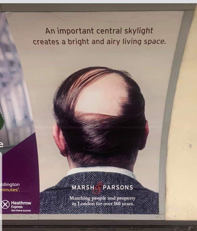 英國一家不動產公司在地鐵中貼出一則海報,將脫髮症比喻作天窗,引起乘客們的不適。圖/Twitter
