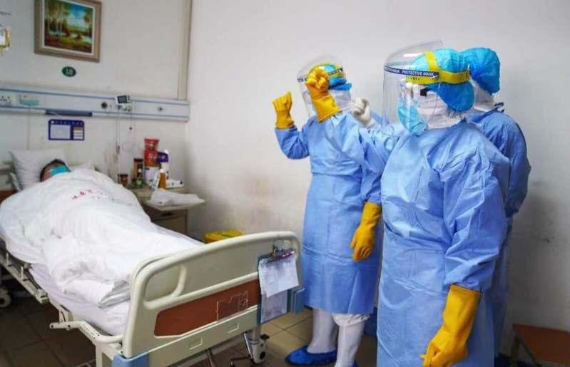 新冠肺炎疫情持續延燒。圖/取自法新社