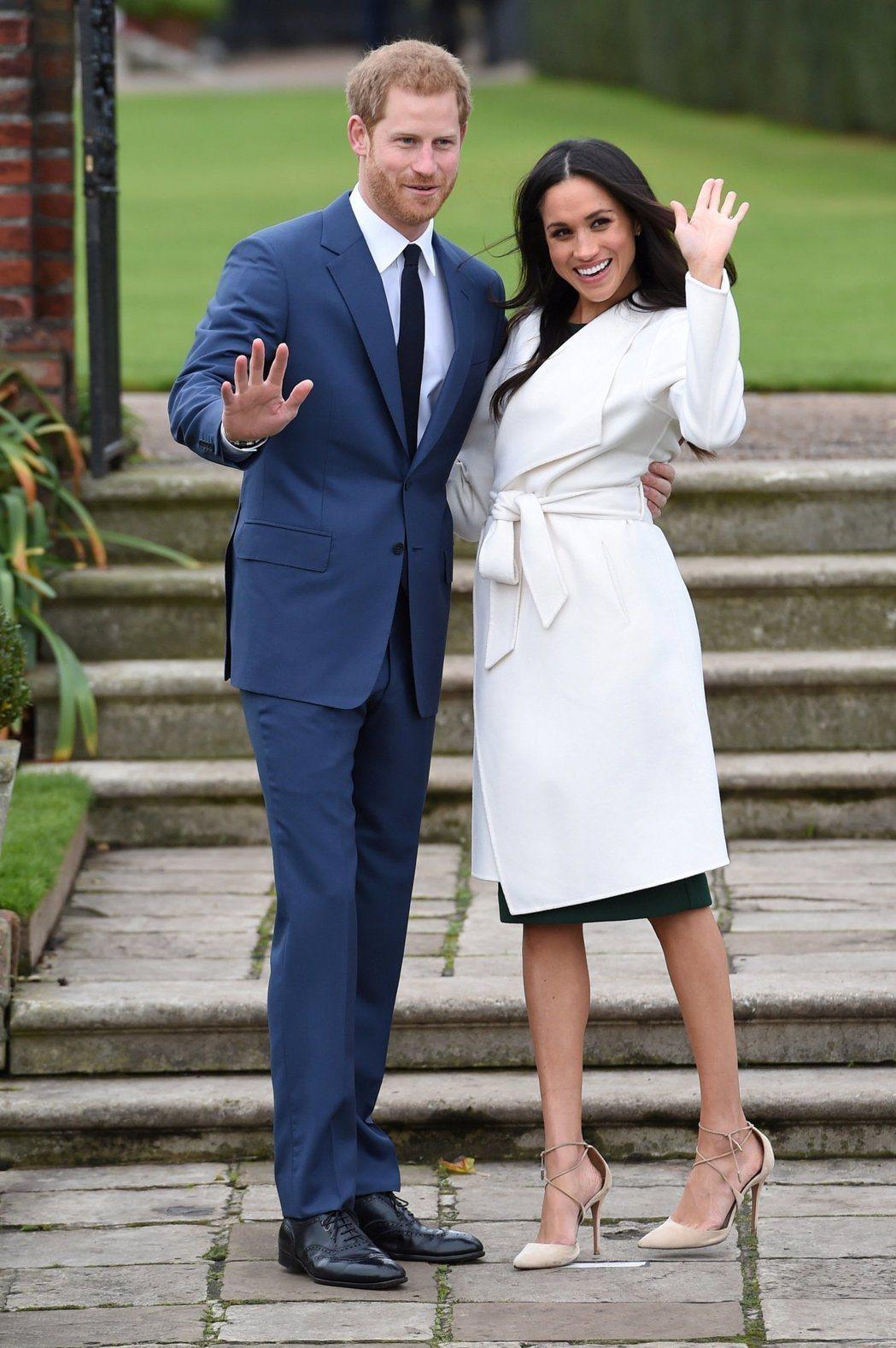 哈利王子與妻子梅根。(路透)