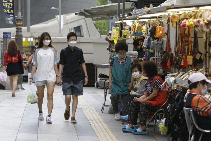 南韓的新冠肺炎(COVID-19)疫情進入社區傳播階段,衝擊觀光旅遊業。圖/美聯社