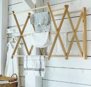 BORSTAD掛牆式晾/曬衣架。能依照需求調整間距,使用後可折疊收納不佔空間,以...