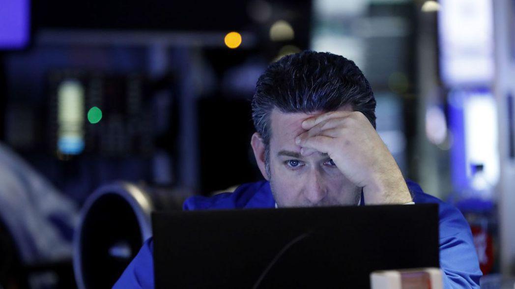 投資人仍認為,新冠肺炎疫情對經濟的影響只是暫時的。 (美聯社)