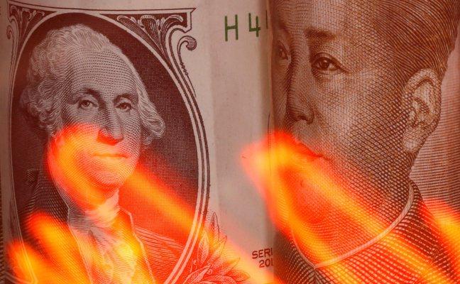 新冠肺炎擴散,威脅亞洲經濟成長,導致亞洲新興貨幣對美元走貶。 路透社