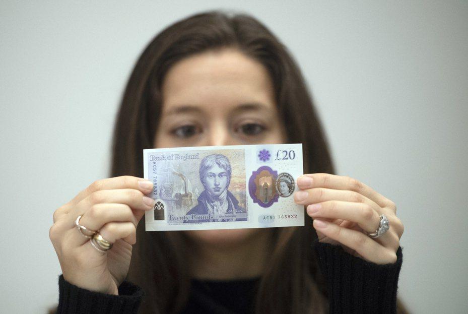 英國開始使用圖中20英鎊新鈔。歐新社