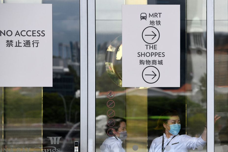 新加坡祭出嚴厲措施控管新冠肺炎疫情。法新社