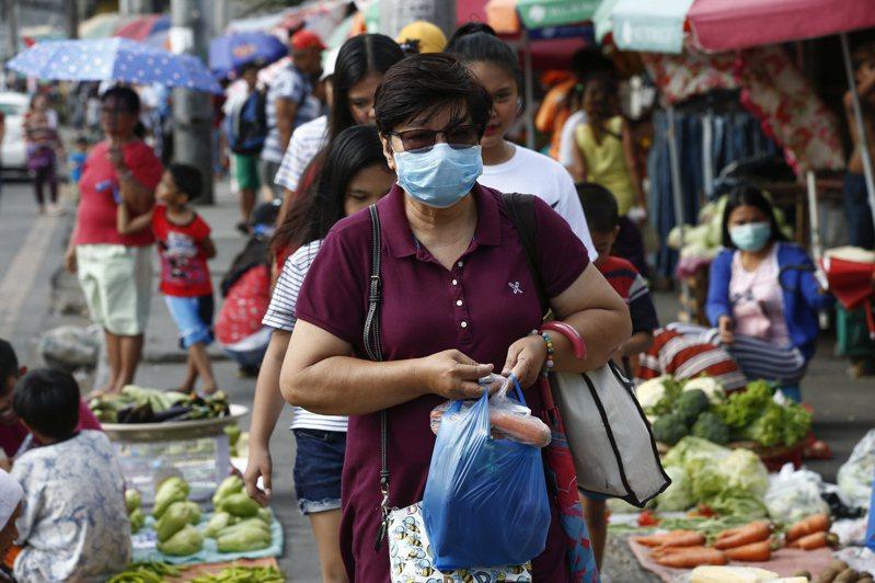 菲律賓新冠肺炎確診數增加到10例。街上部分民眾也戴起口罩。 歐新社
