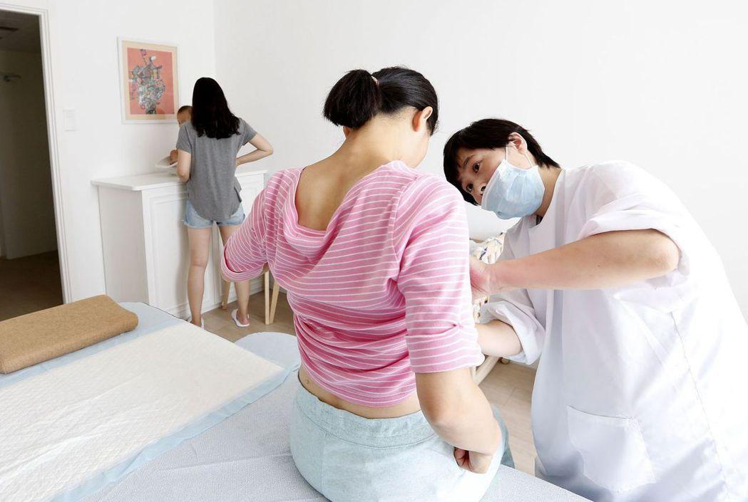 大陸婦女有14周產假。 (新華社)