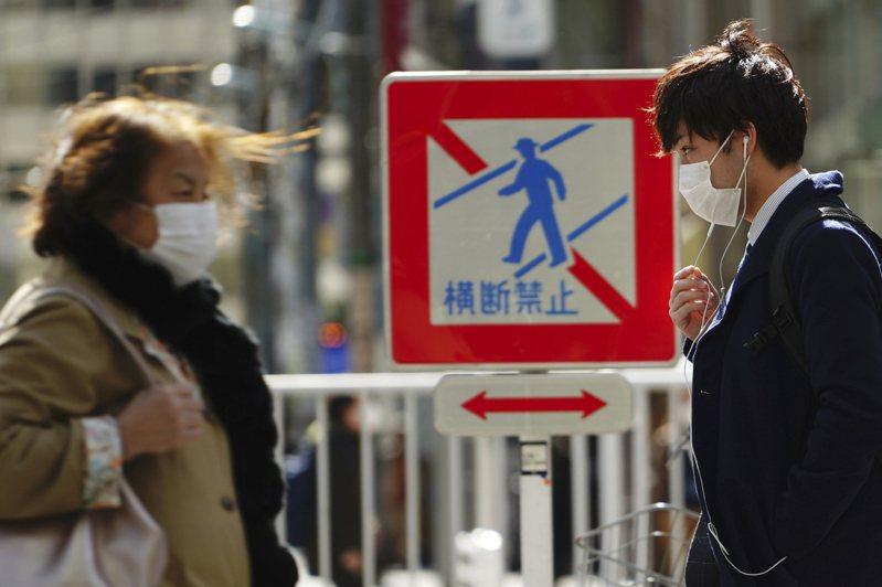 新冠肺炎在日本持續延燒。美聯社