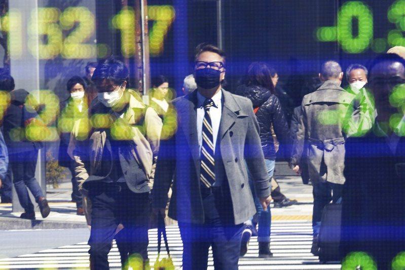 新冠肺炎衝擊全球經濟。 美聯社