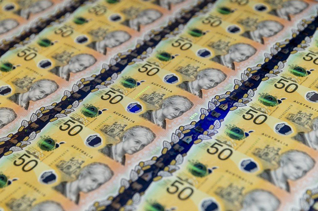 澳洲央行又降息1碼至0.25%。(圖/歐新社)