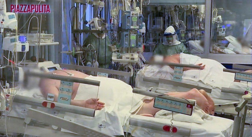 3月5日,義北克里莫納醫院(Cremona hospital)加護病房,躺滿新冠...