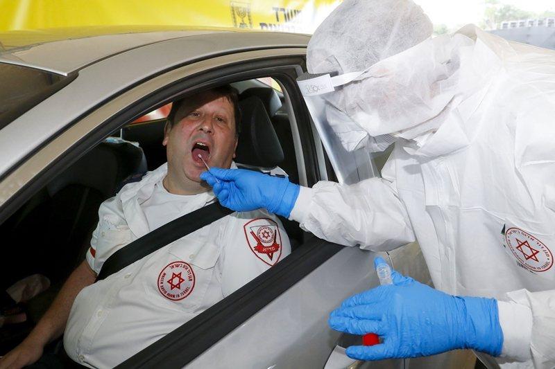 蒐集獲取的資訊,由國家衛生部門因應疫情加以保管控制及利用。圖攝於3月20日。 圖/法新社