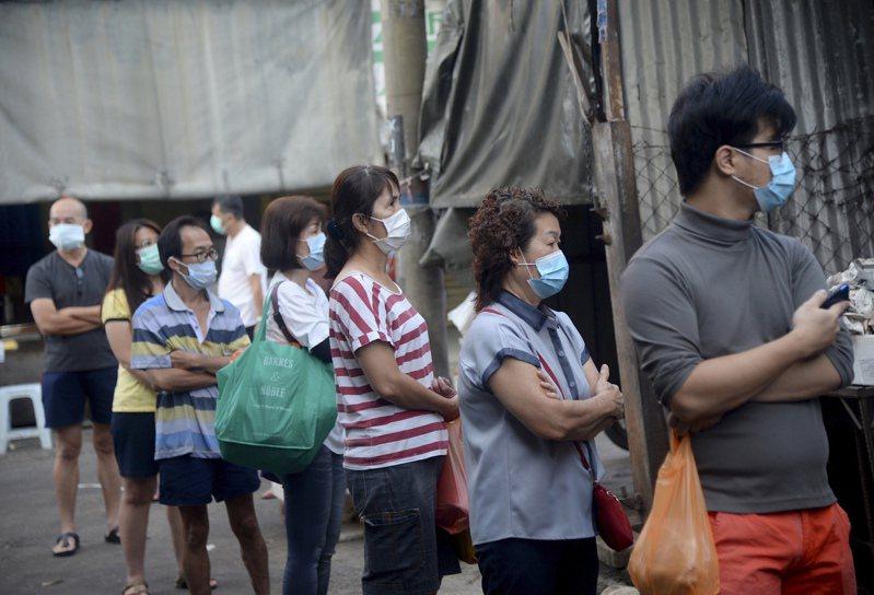 馬來西亞政府還首度推出總額59億令吉的工資補貼計畫,約330萬工人受益。圖/美聯社