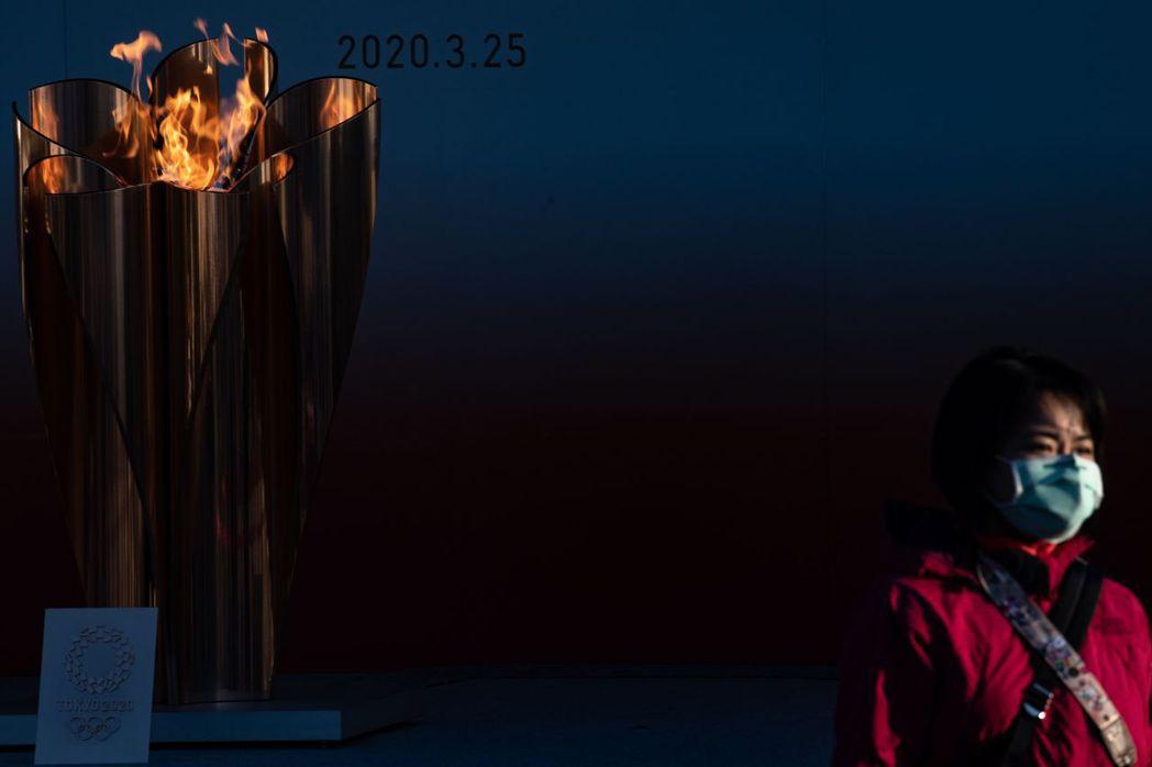奧運聖火在311大地震重災區宮城、岩手、福島這3縣進行巡迴展示。圖攝於3月25日,福島。 圖/法新社