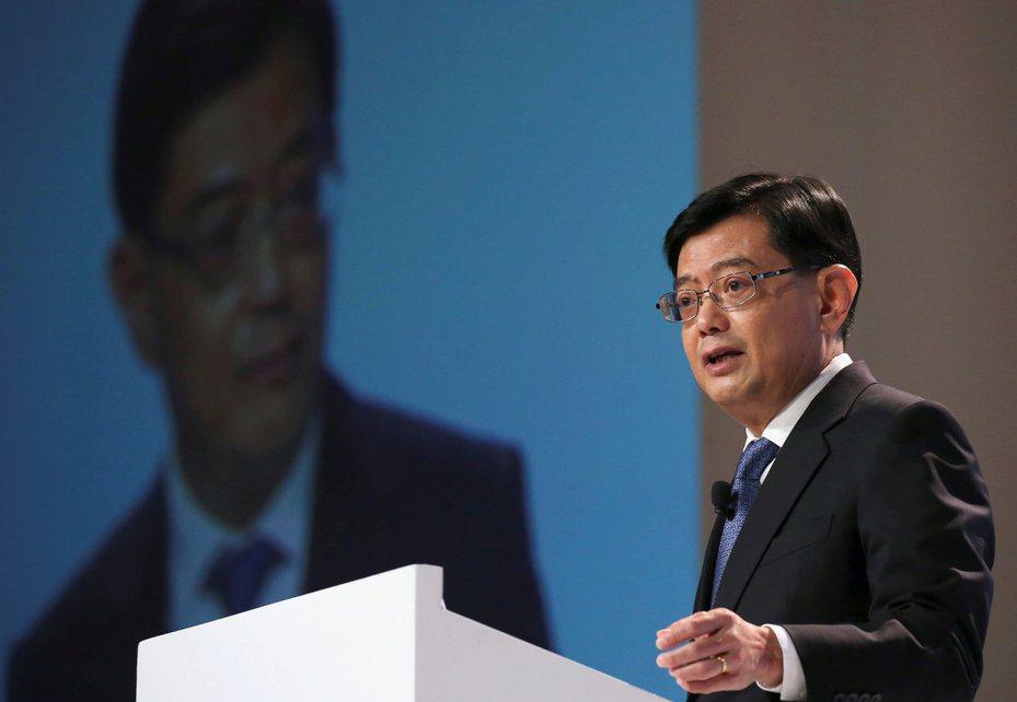 新加坡副總理兼財政部長王瑞杰宣布政府官員集體減薪。圖/路透資料照片