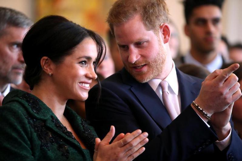 哈利王子與梅根。路透