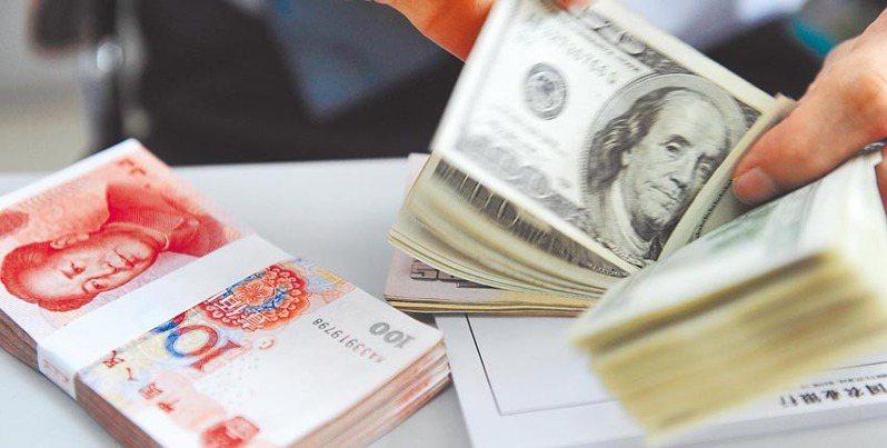 交通銀行台北分行預估,疫情拐點到來前,人民幣對美元走勢偏弱。報系資料照