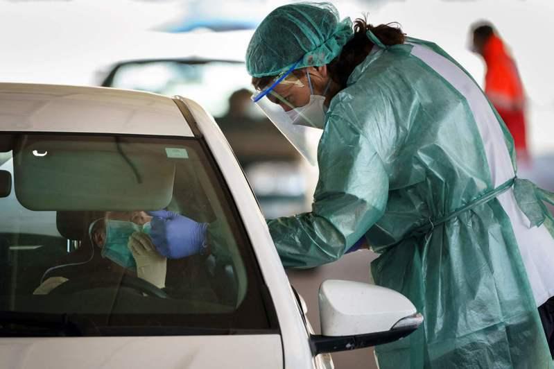 西班牙新冠肺炎累計確診94417例。圖/法新社