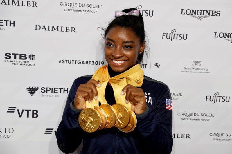 美國體操天后拜爾斯(Simone Biles)也直言,奧運延期一年對於體操選手來說是一件非常煎熬的事情。 路透