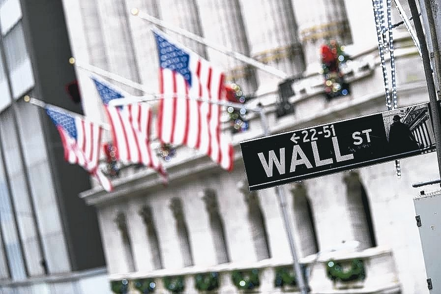疫情導致企業不發股利。 美聯社