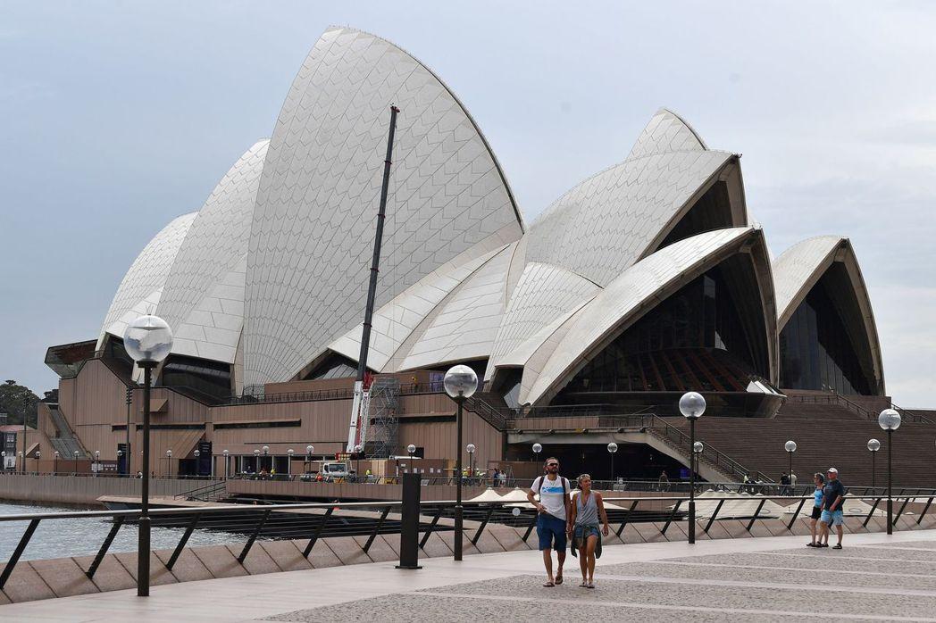 澳洲房地產低迷、澳幣貶值,可能有更多外國客購買澳洲住宅房地產。法新社