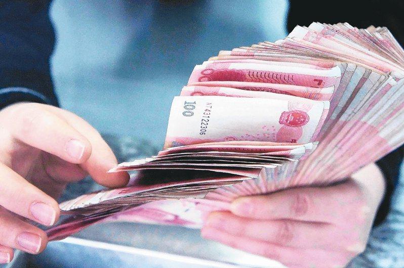 全球疫情蔓延,避險升溫,市場期望中國人民銀行進一步放寬貨幣政策力道。不過,美指再度站上100相對高位以及人行定向降準,皆對人民幣後市仍形成壓力。本報系資料庫