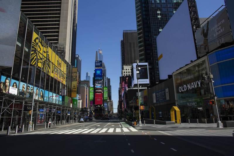 全美多座城市實施居家避疫令,紐約時報廣場6日空無一人。法新社