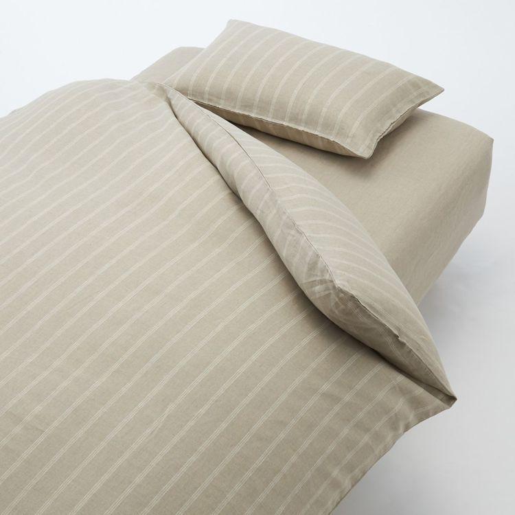 生日慶期間購買亞麻平織床包搭配被套與枕套各一件,享成組9折優惠。圖/無印良品提供