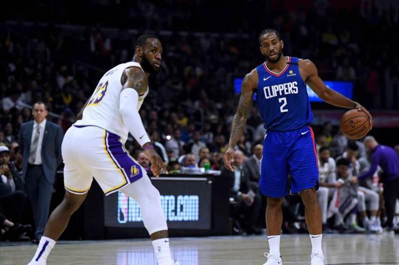 洛杉磯今年將禁止所有大型集會,代表NBA若復賽,冠軍熱門湖人與快艇恐怕無法在自家主場奪下冠軍。  法新社