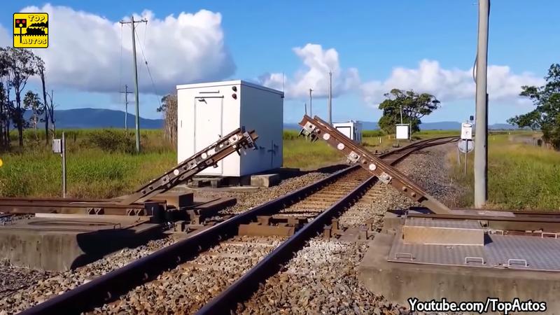 澳洲某處的交叉鐵路,選擇使用少見的上開橋式交叉。圖/YouTube