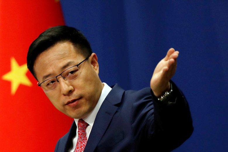 中國外交部發言人趙立堅3月12日一則「新冠病毒是由美軍帶到武漢」的推文,引爆中國試圖甩鍋疫情責任的批判。 圖/路透社