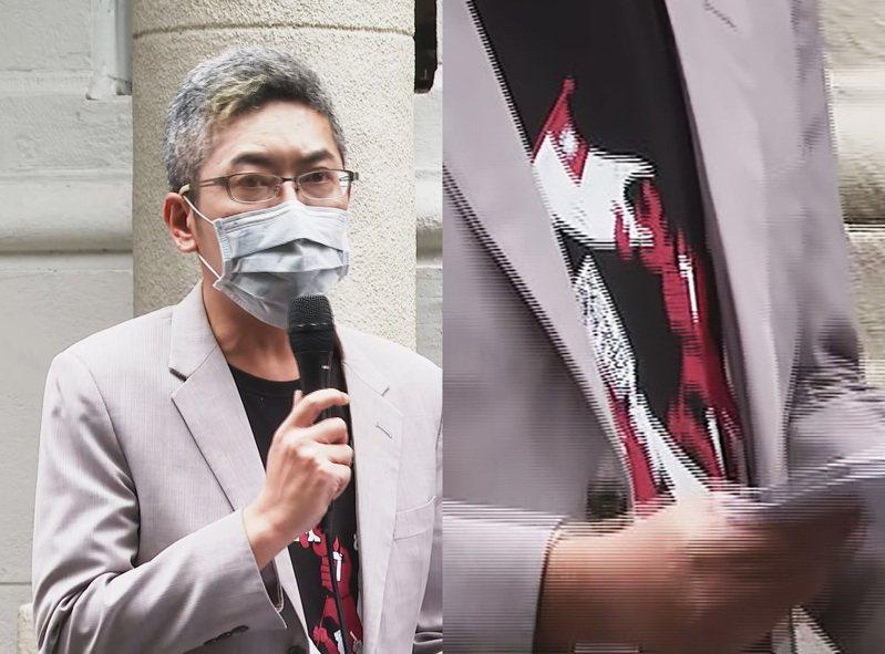 總統府發言人丁允恭身著燒國旗衣的T恤,引發不少質疑。 記者陳煜彬/攝影