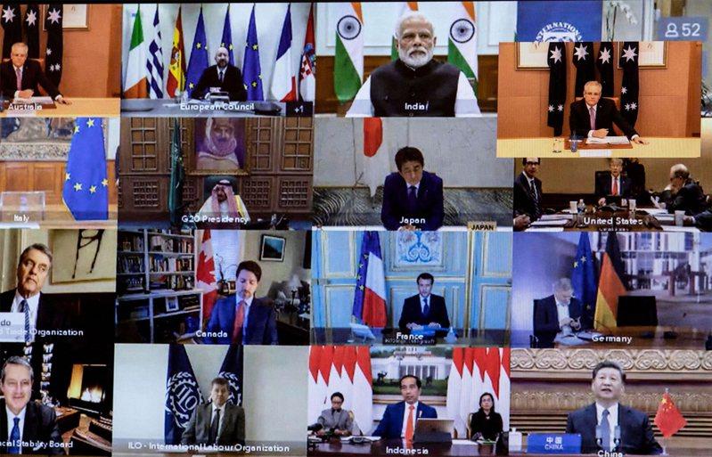 圖為3月26日20國集團領導人舉行的視頻會議,討論COVID-19冠狀病毒的問題。圖右下為中國國家主席習近平。法新社