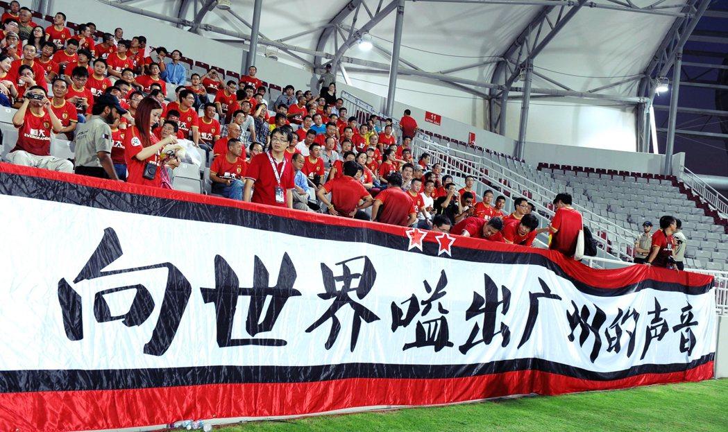 恆大的足球之路,就是中國政治經濟發展的某種縮影。 圖/中新社