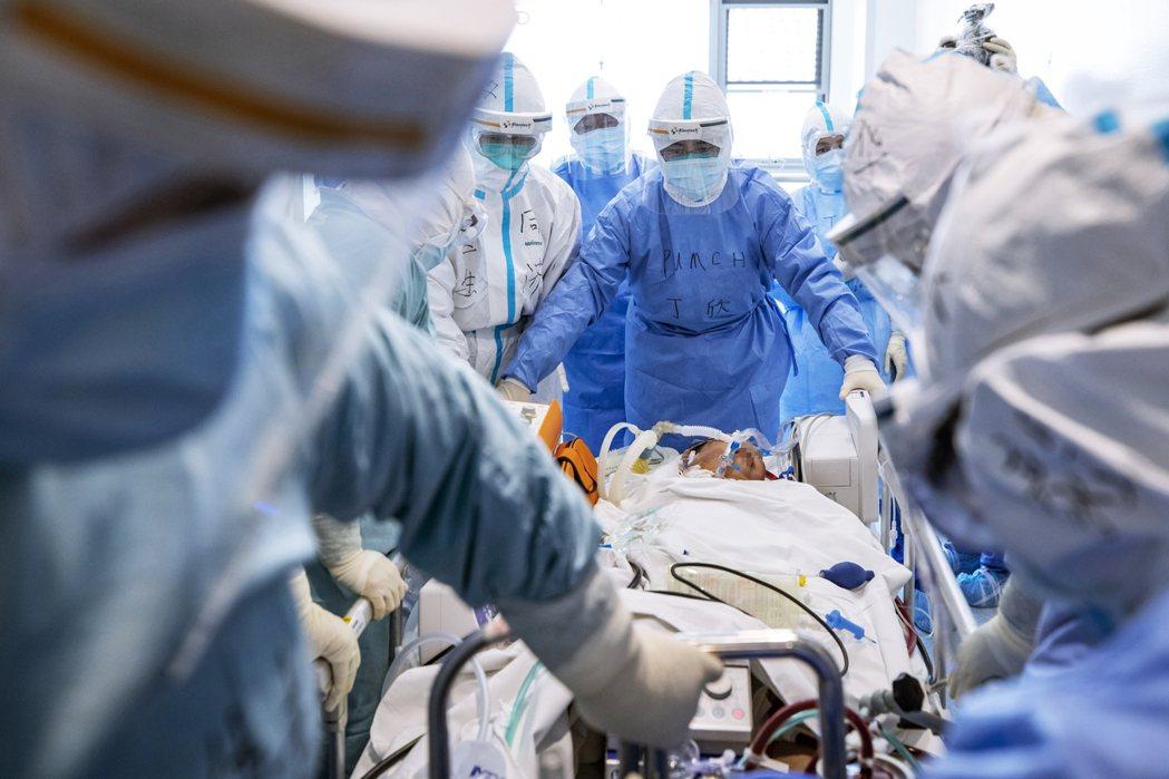 這份外流的中國臨床報告,是以237名武漢肺炎患者為實驗對象。圖為武漢醫院。 圖/...