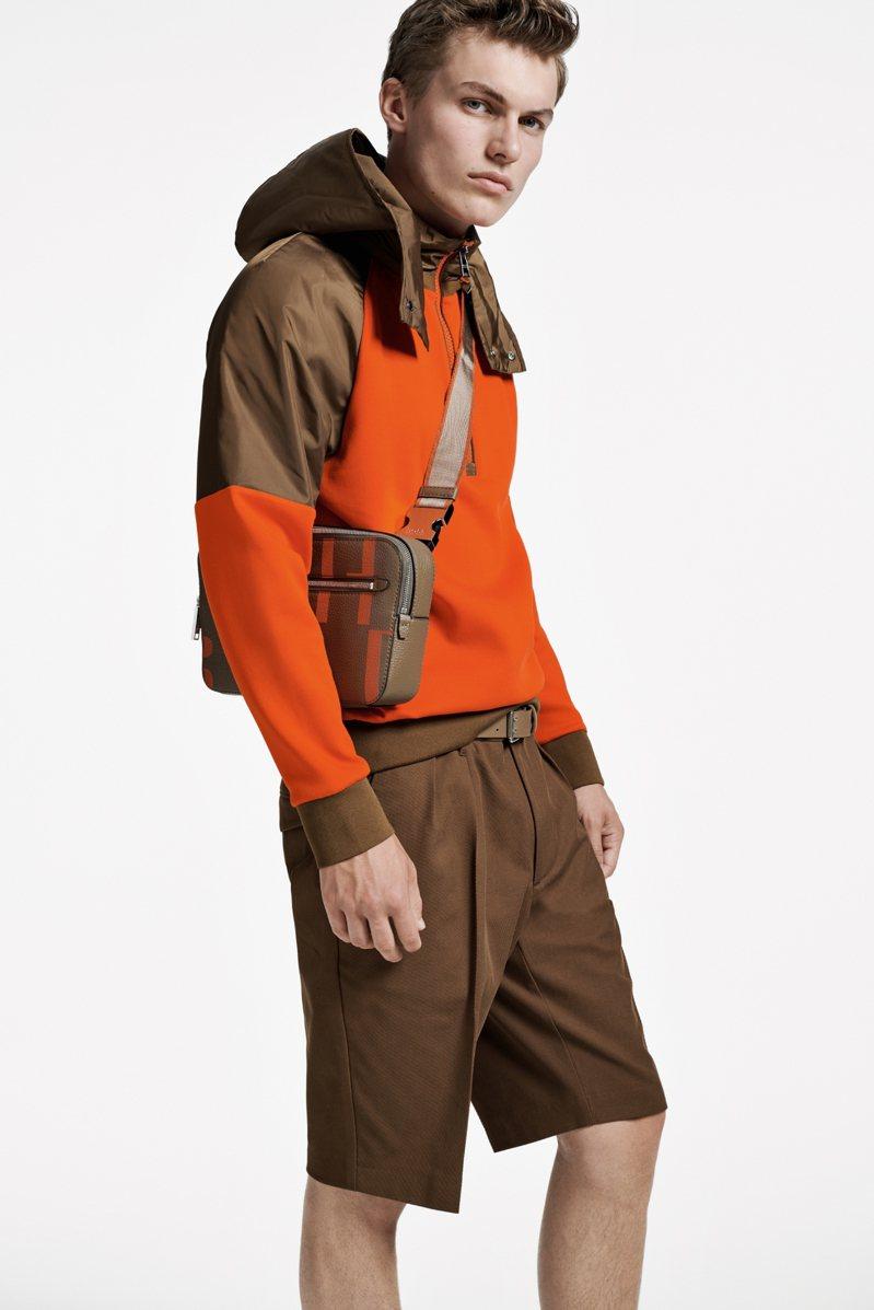 BOSS,橘棕色尼龍拼接棉質功能性上衣,價格未定;褐色短褲6,900元。圖 / BOSS提供。