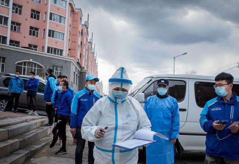 中國近期屢見隔離期滿後發病的2019冠狀病毒疾病患者,多地延長隔離期。圖為黑龍江一處衛生服務中心。 法新社